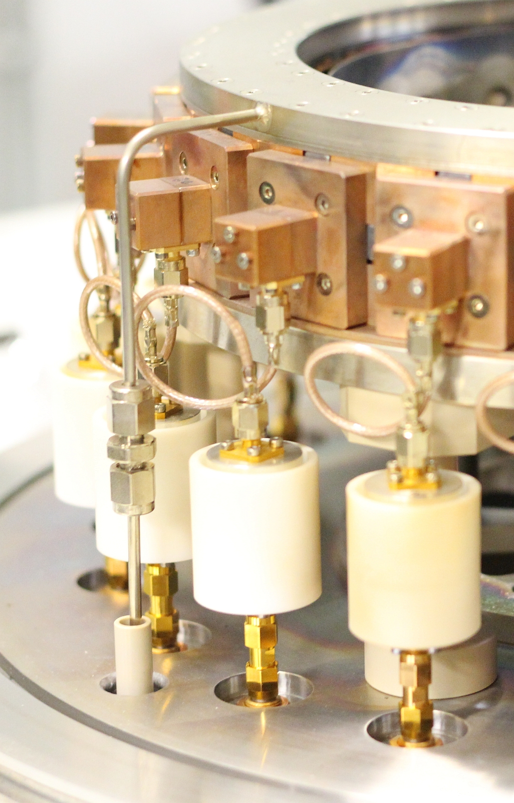 Close-up of a 20-source circular array of a multi beam sputter deposition system