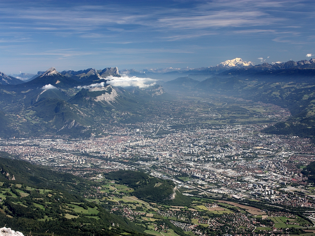 Photo of the city of Grenoble taken from Pic St Michel in the Vercors Massif, showing the Chartreuse Massif, the Grésivaudan valley and the Mont Blanc