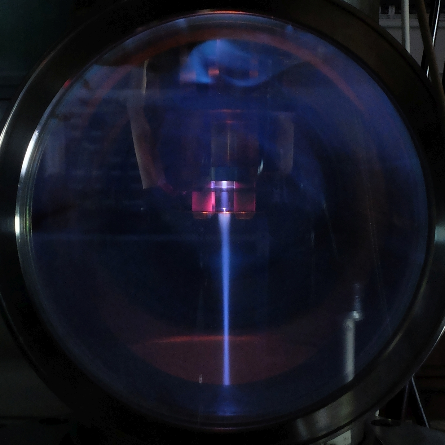 Photo of 100mA electron beam generated by single cavity ECR source