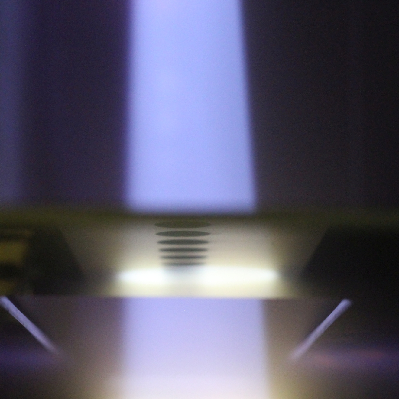 Photo of linear ion beam of 150x500 mm, seen from the 150 mm side