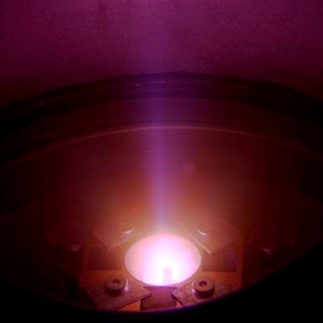 Photo of open ECR plasma cavity with plasma on