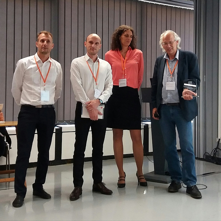 Photo of the jury and Polygon Physics' president Pascal Sortais holding the SFV Innovation Award 2017